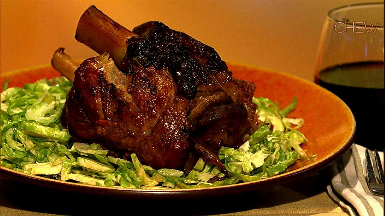 Michael Symon's Braised Pork Shanks with Shaved Brussels Sprout Salad recipe. #thechew