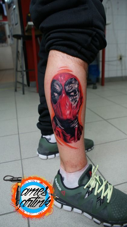 Sick realistic coloured deadpool tattoo by James Artink