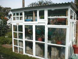 greenhouse assembled from salvaged windows