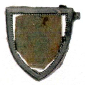 Part of mirror-badge with glas in shield-shaped frame with pearl border