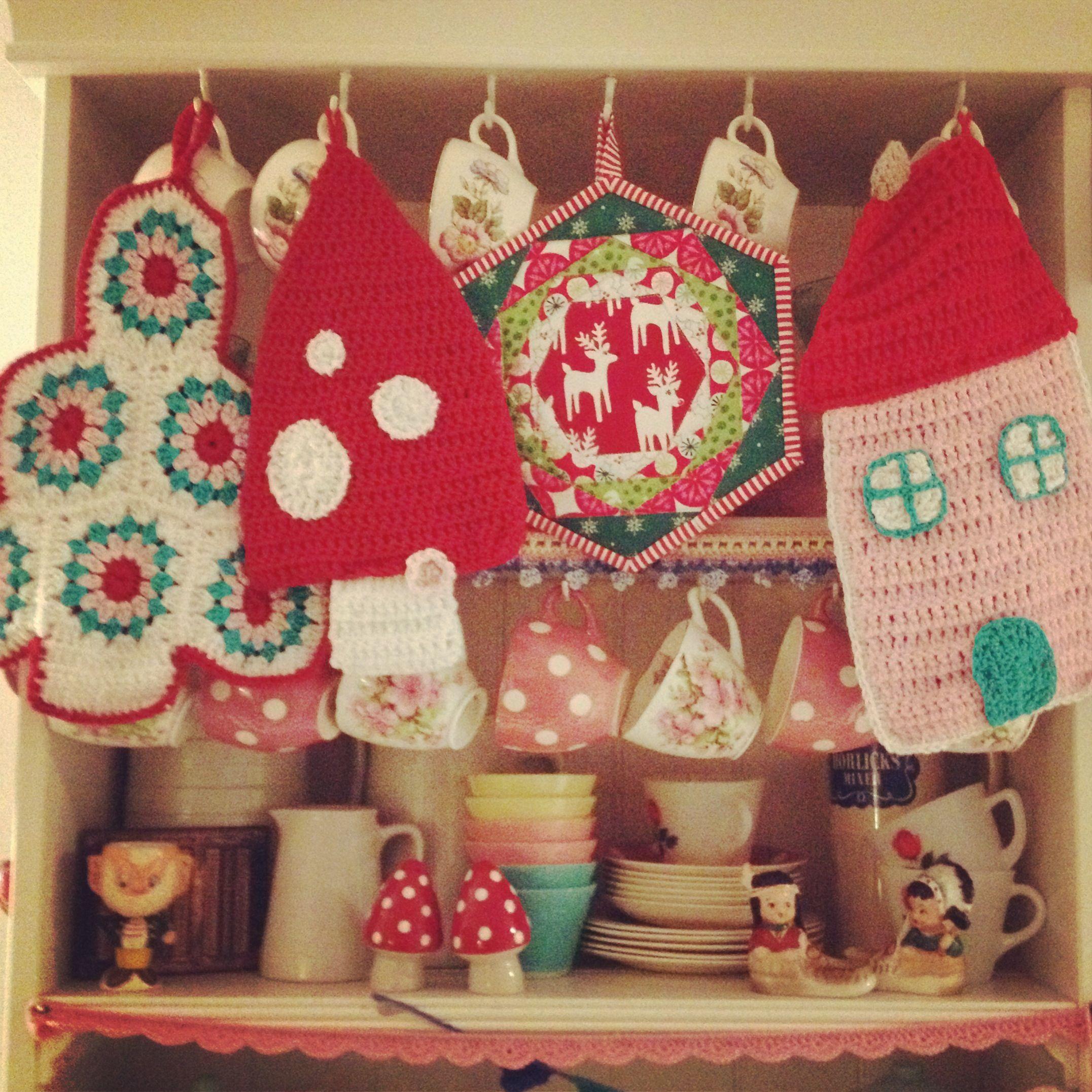madebymim crochet potholders and a @Helen Palmer Palmer Palmer P  beautiful quilted potholder on my dresser