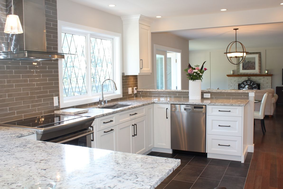 Snow white quartz countertop on painted white cabinets for Pictures of white kitchen cabinets with granite countertops