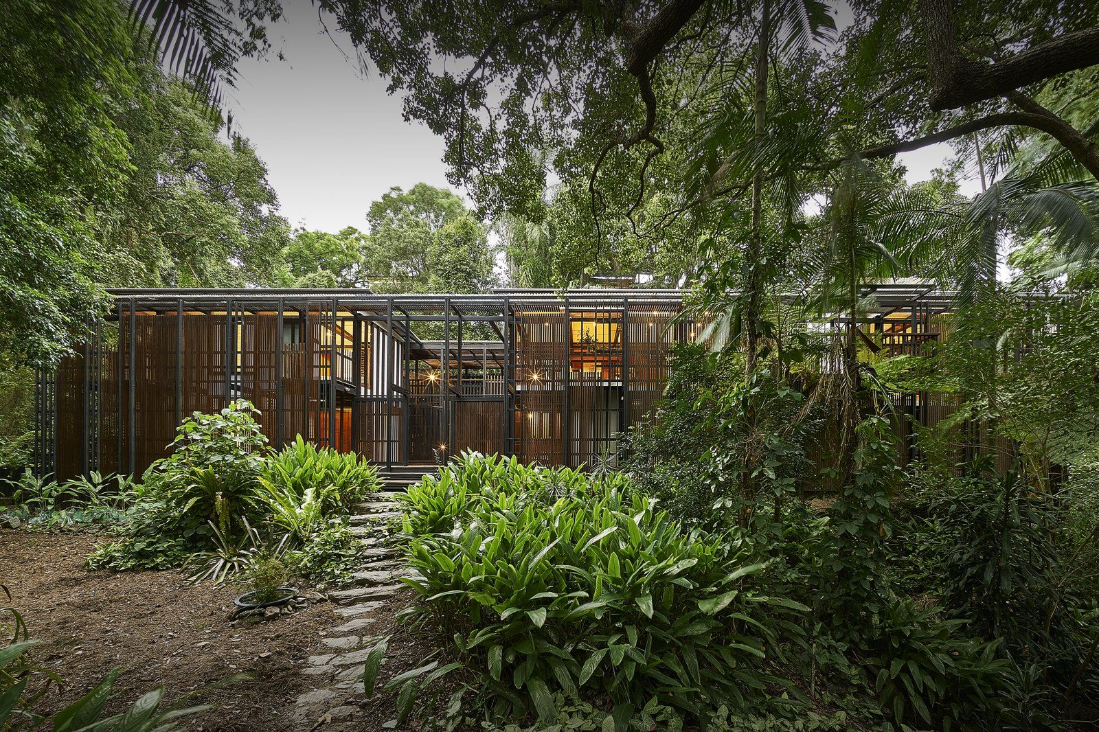 This Brisbane Home For Sale Is A Lush Sanctuary Caribbean Homes House Landscape Curbing