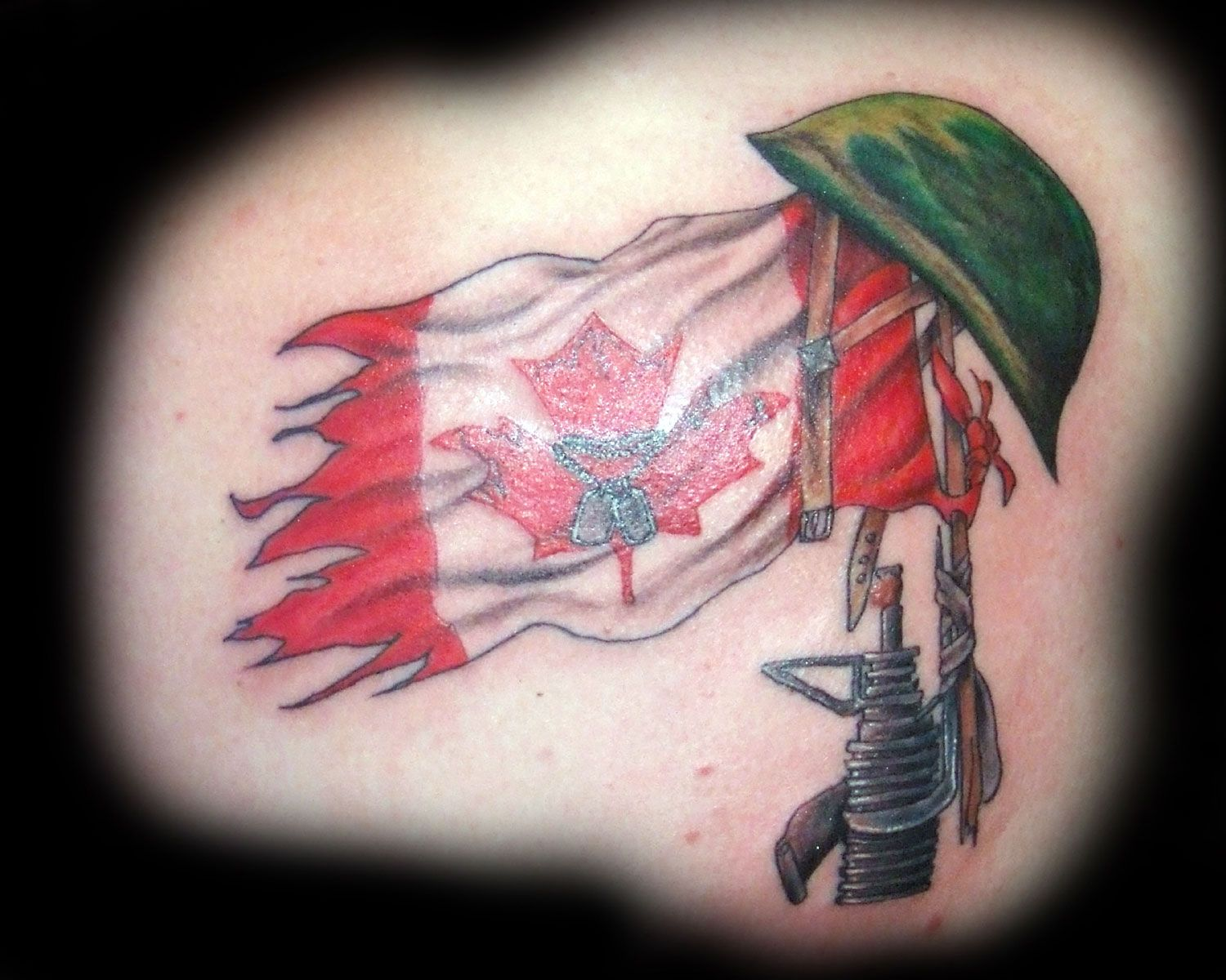 Name canadian flag ripping through skin tattoo designjpg pictures - Canadian Flag Tattoos Designs
