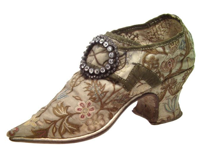 Pair of woman's shoes (wedding shoes), England, c. 1700-1730. Cream silk embroidered with flowers and floral motifs im multicoloured silks.