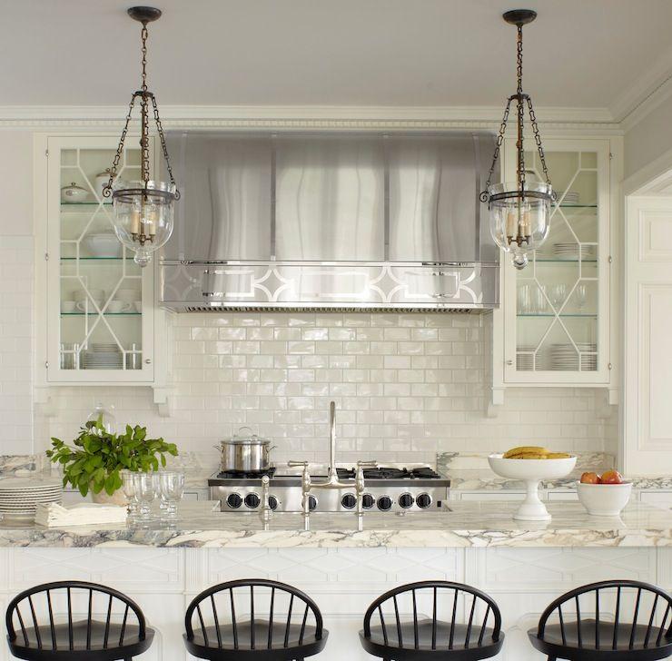 Large Subway Tile Kitchen Backsplash: Gorgeous Kitchen With Glass Front Upper Cabinets Echoing
