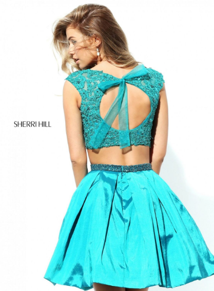 Check out this new Sherri Hill short dress Perfect for this years homecoming.  Featuring a lace crop top and a taffeta skirt.