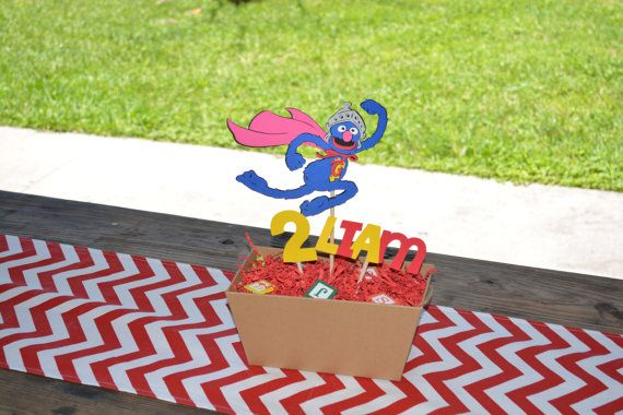 Super Grover Centerpiece Stick With Childs Age and Name    I make them out of cardstock Paper then I put them on a wood stick.    I can make