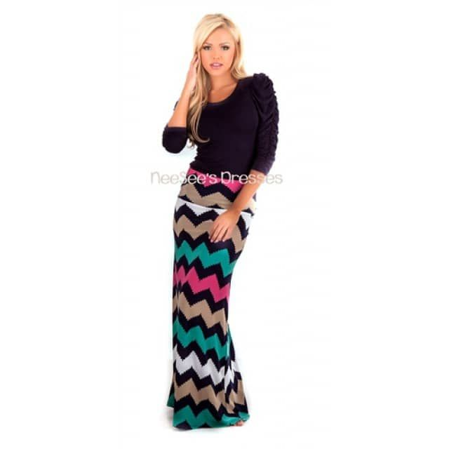 Trendy, slinky maxi skirt with navy, mocha, teal and fuchsia chevron print.Shown With: Thin Satin Collar Top in NavyExtended InformationIf you run between sizes and are not sure what size to get, we would suggest going up a size. For instance, if you are a 4/5 we would suggest going with the Medium. If you are a 8/9 we suggest going up to the Large!