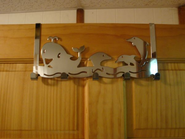HOOD'S West Alton, Missouri has two types of chrome door hangers.  These would be great to hang on your bathroom door for towels, robes, and etc. These can also be used as a coat hanger.  One features whales and the other one is frogs.