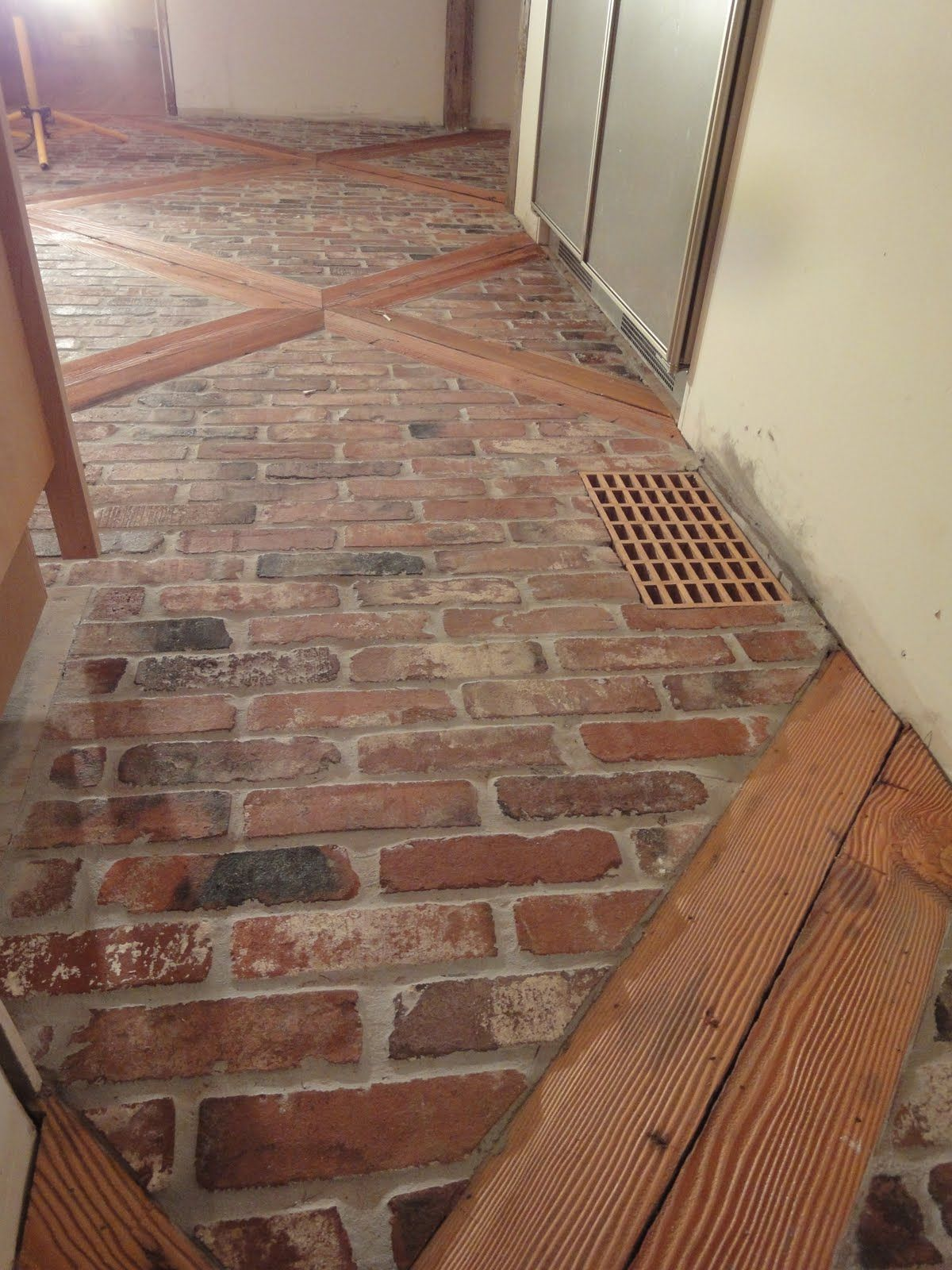 After 2 weeks and nearly 50 hours of work the kitchen floor is brick floor for hallway and mudroom with reclaimed wood crisscrossed throughout the brick 1900 farmhouse kitchen flooricks and wood great design dailygadgetfo Images