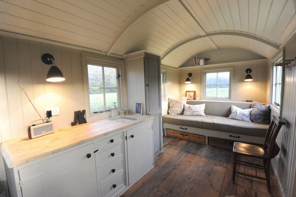 Scandinavian accent Shepherd Hut. The cupboard could be made a little deeper for hanging clothes and bedding.