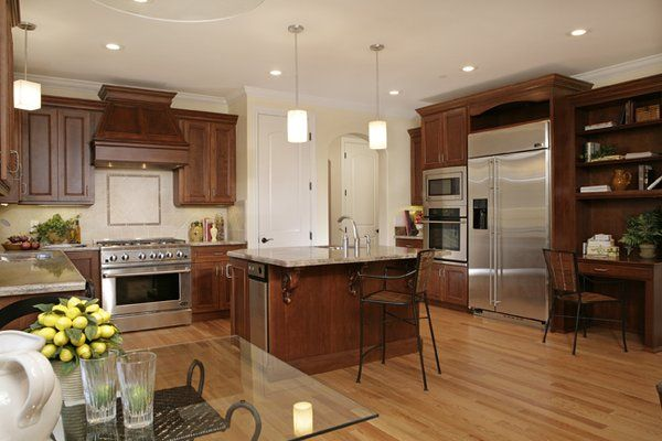 Kitchen with cherry cabinets, granite counter tops and red oak ...