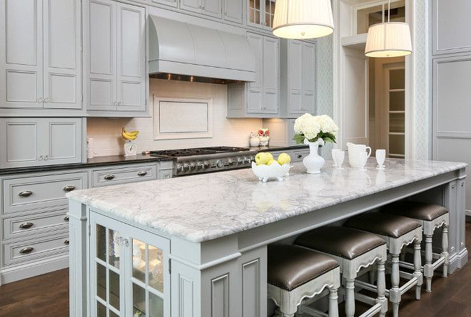White Quartzite Countertop On The Island And Soapstone