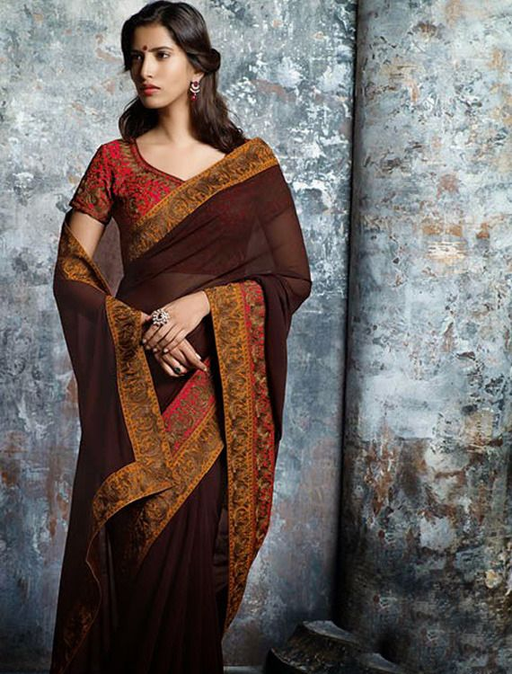 86a2f738c0b4b This plain brown georgette saree with adorable heavy work border   contrast  red blouse is truly a Leader. A simple saree with a unique twist!