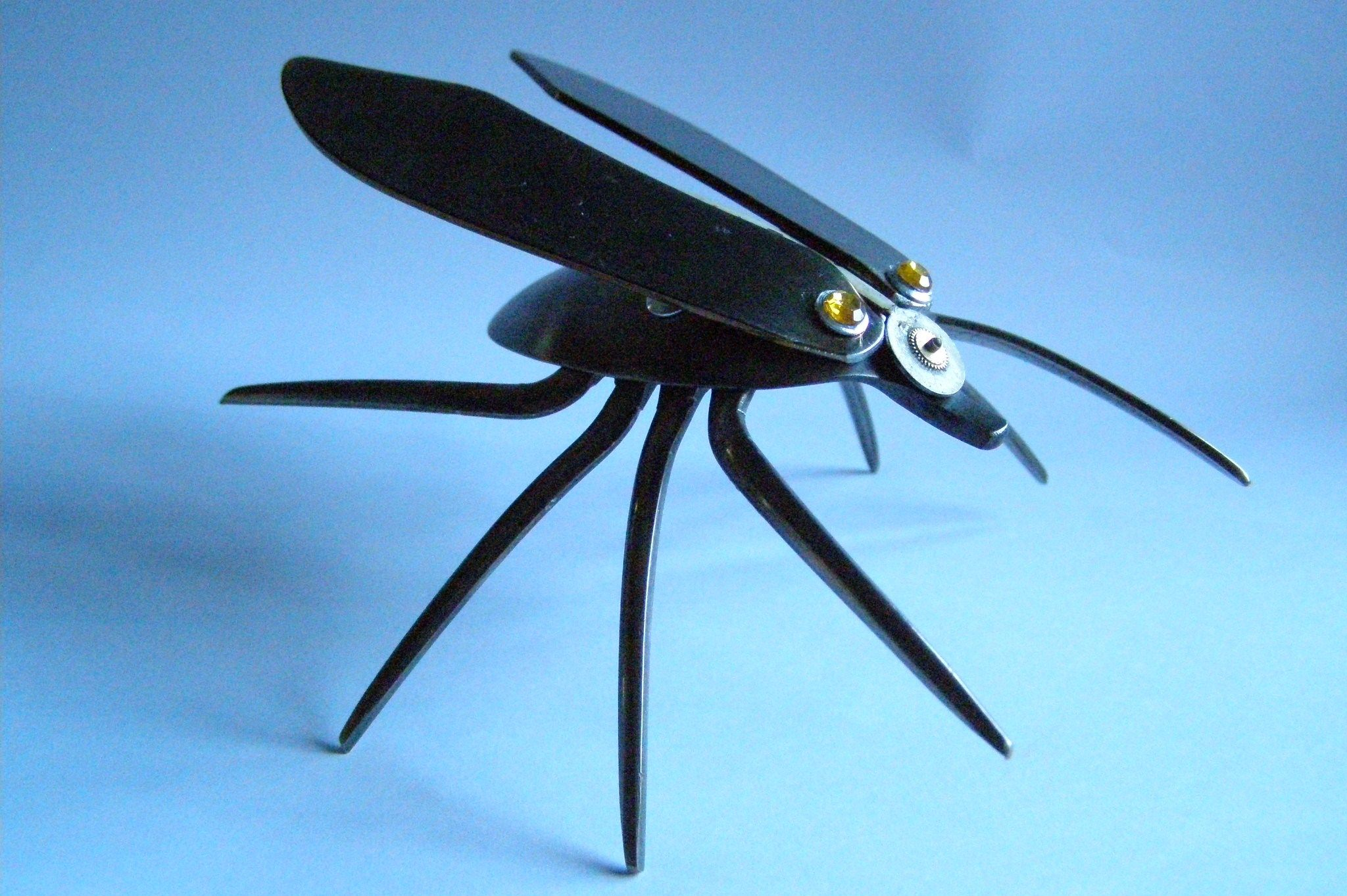 A large winged bug with watch hand detail. Now sold.
