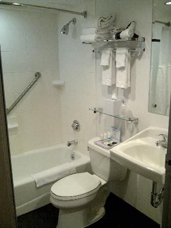 Bathroom Small But Functional Shelving Above Toilet In