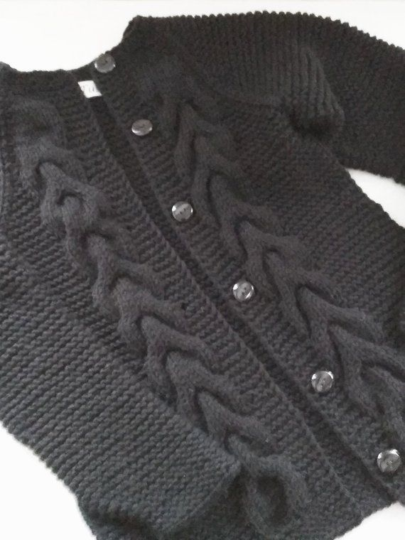 85309e564225f4 Black knit cardigan with cables
