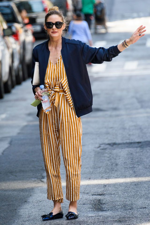 2 June Olivia Palermo looked chic in a striped jumpsuit, which she paired with a navy silk bomber jacket for an outing in New York.