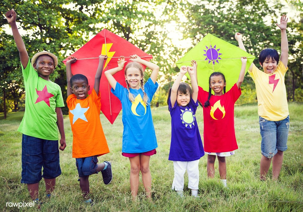 Download Premium Image Of Diverse Kids In Colorful Shirts Holding Kites