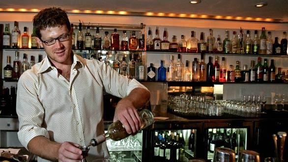 Bar manager Justin Pike mixes a drink at the Tasting Kitchen in - bar manager