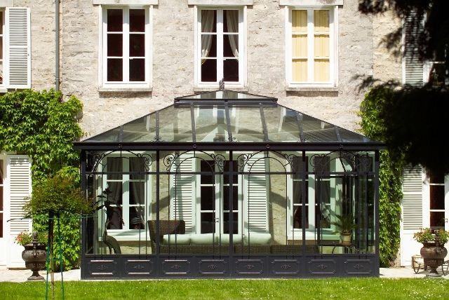 Photo  véranda avec toiture en verre double vitrage topping - maison avec toit en verre