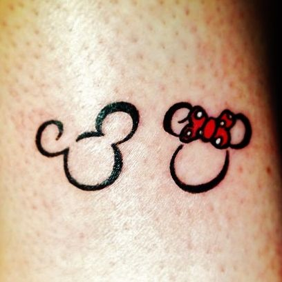 Minnie & mickey mouse disney tattoo... yep. Me and Gene got these last night on our ring fingers. :)