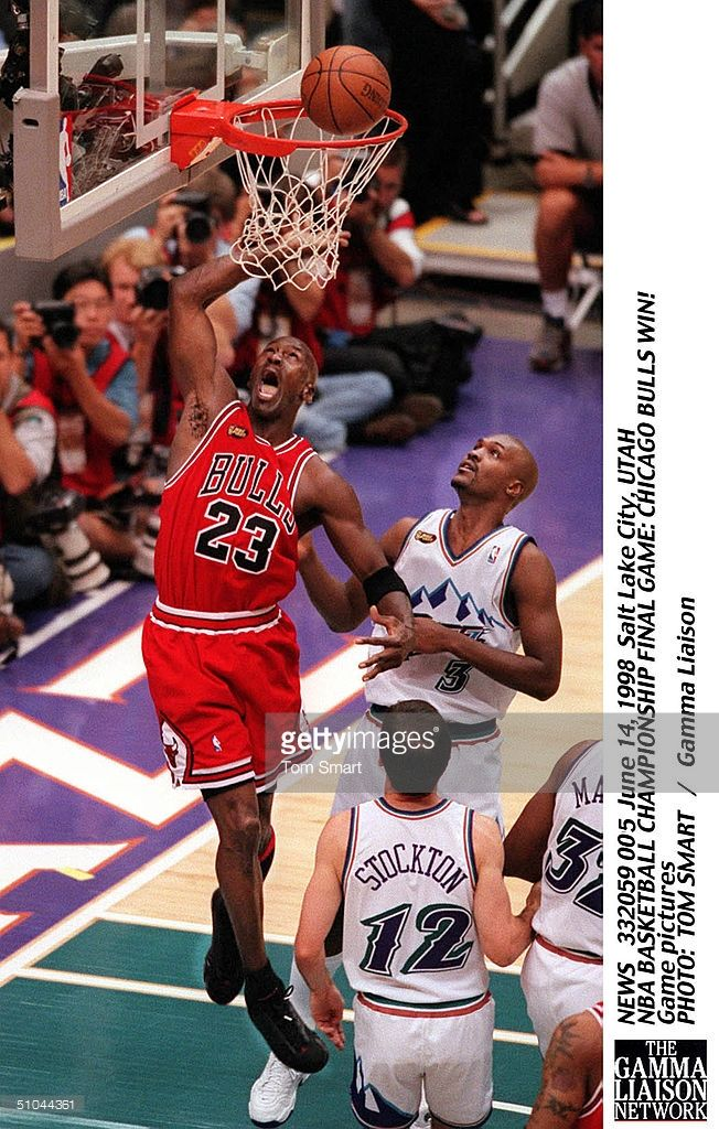 Michael Jordan #23 of the Chicago Bulls shoots a lay up past Bryon Russell #3 of the Utah Jazz during Game 6 of the NBA Finals at the Delta Center on June 14, 1998 in Salt Lake City, Utah.