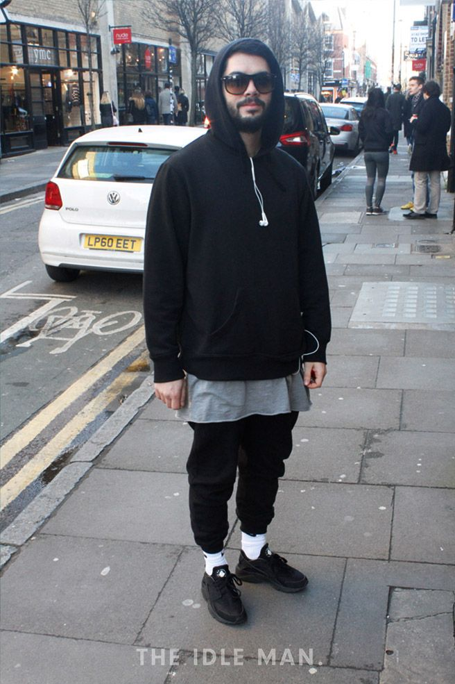 Men's street style, a classic street look with a long line tank, an oversized hoodie, joggers and black plimsolls. | Shop men's shoes, clothes and accessories at The Idle Man