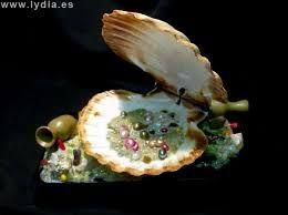 Resultado de imagen de decorar con caracolas de mar