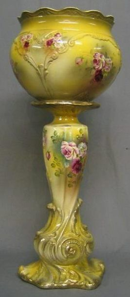 A Victorian pottery jardiniere stand.