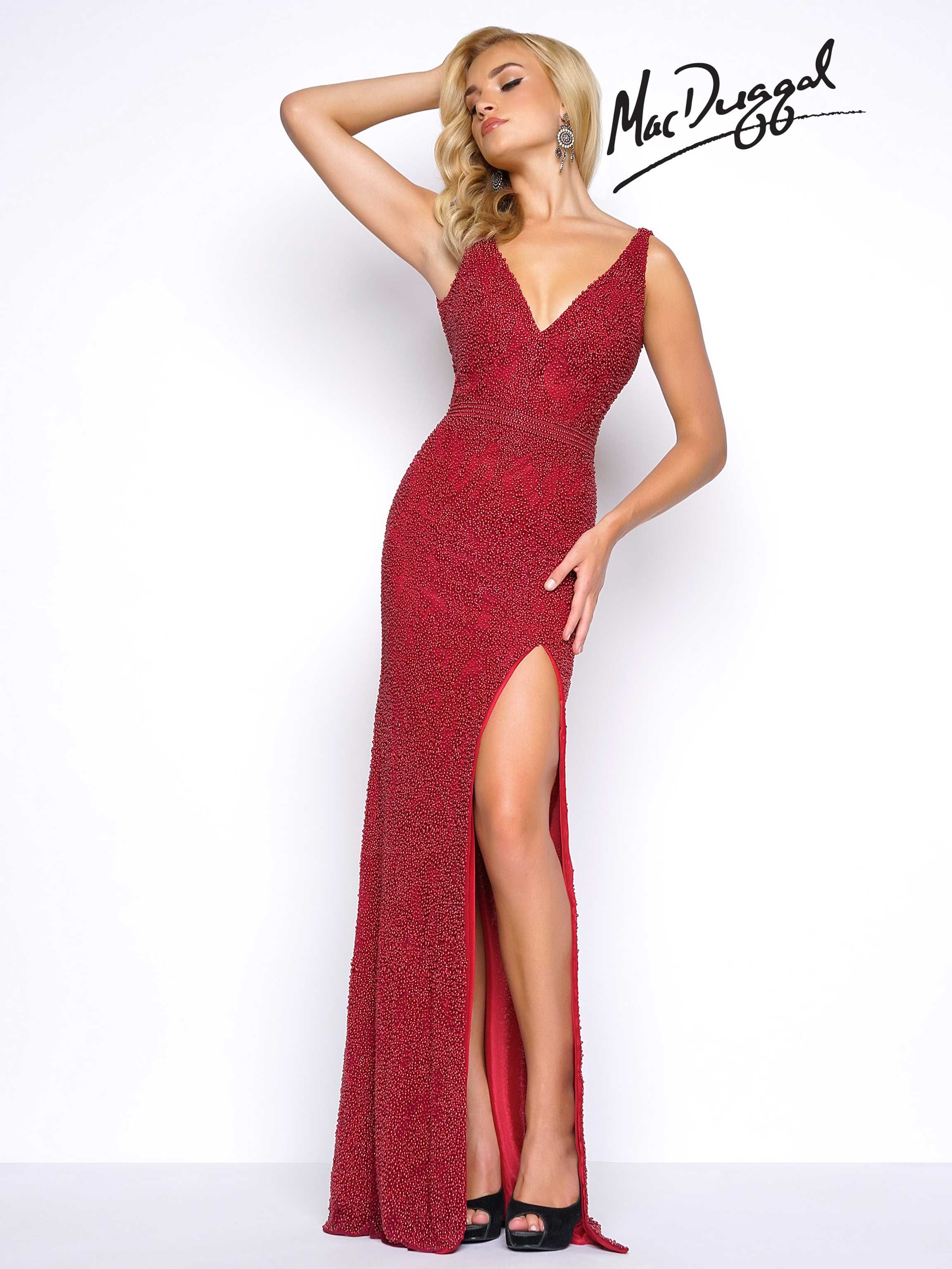 Fully beaded prom dress with pearl beads. The dress includes a plunging V- neckline 3896d6a86