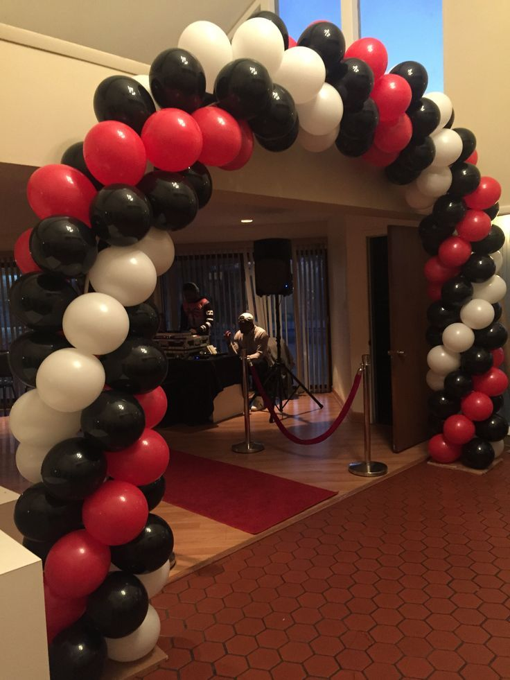 Super red black and white spiral balloon arch We could also