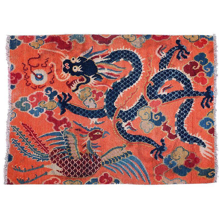 charming antique tibetan dragon and phoenix sitting rug | asian