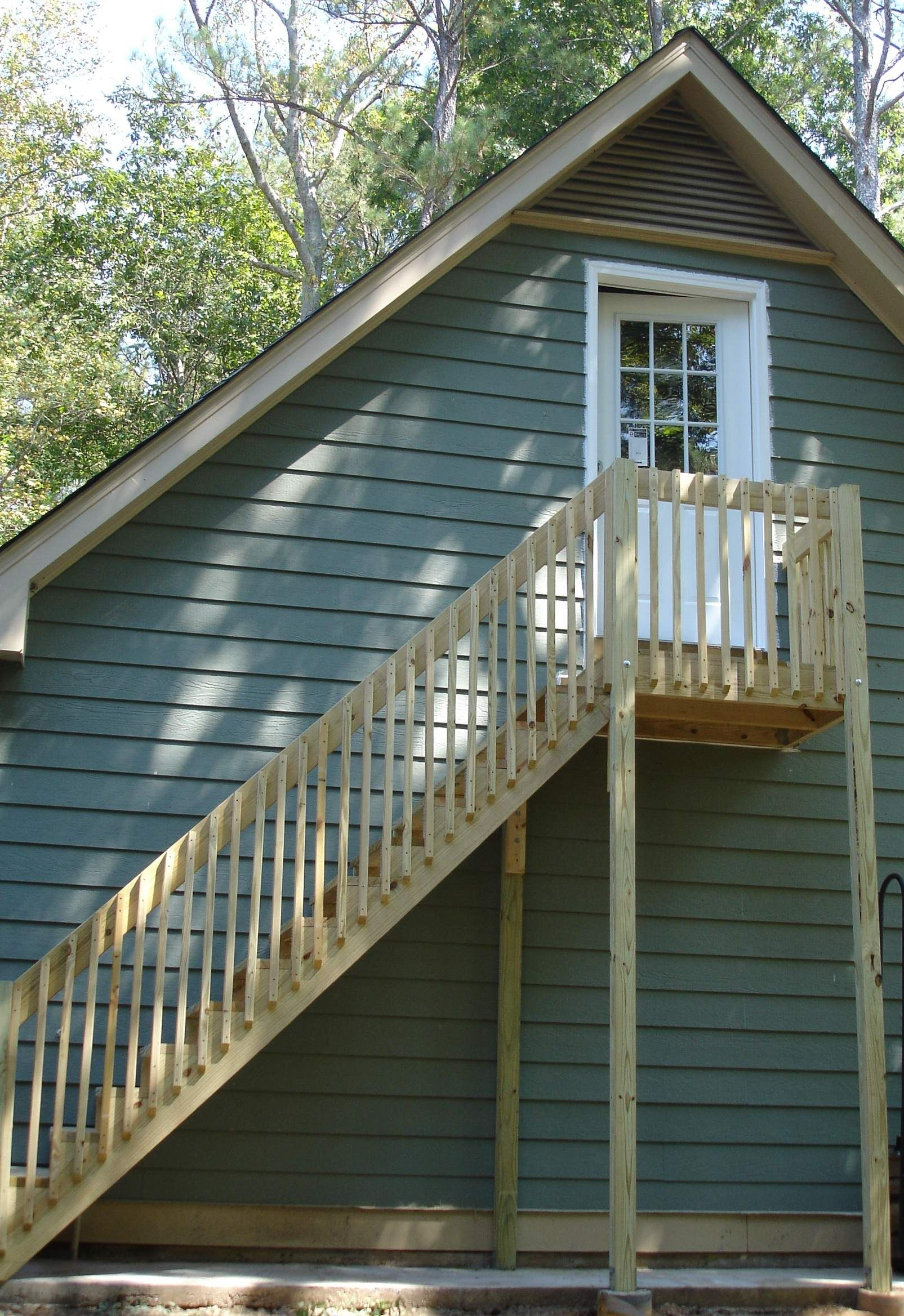 Exterior stairs making previously wasted space over garage ...