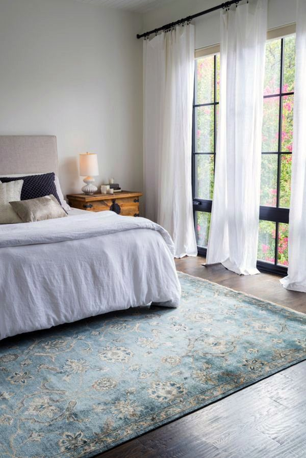 black curtain rod, white curtains, pale blue green rug | Relaxing ...