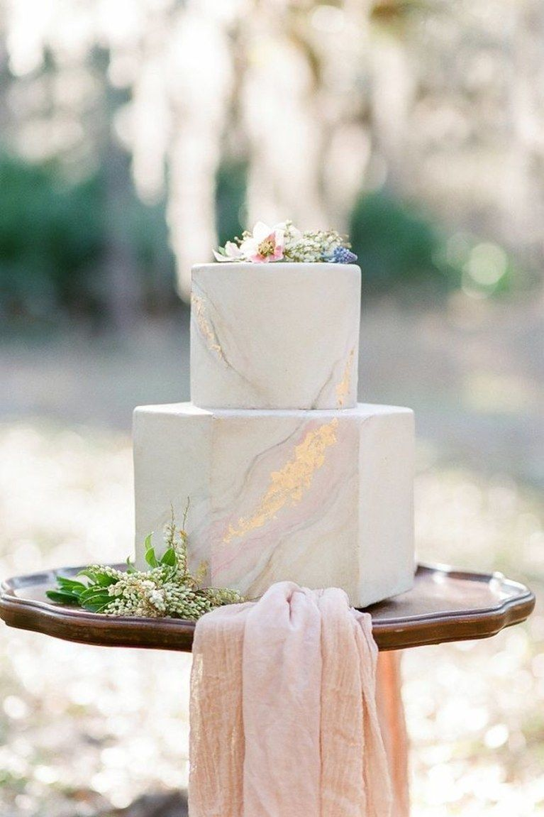 Twotier hexagonal marble wedding cake with shades of pink and
