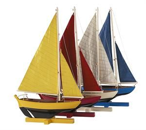 From Authentic Models for just $75, those set of four miniature sailboat models are great for bedroom decor, kids decor or any home decor. Wooden hand built flotilla of four sailing dinghies features fresh, bright and sunny colors. Precious and Fun!
