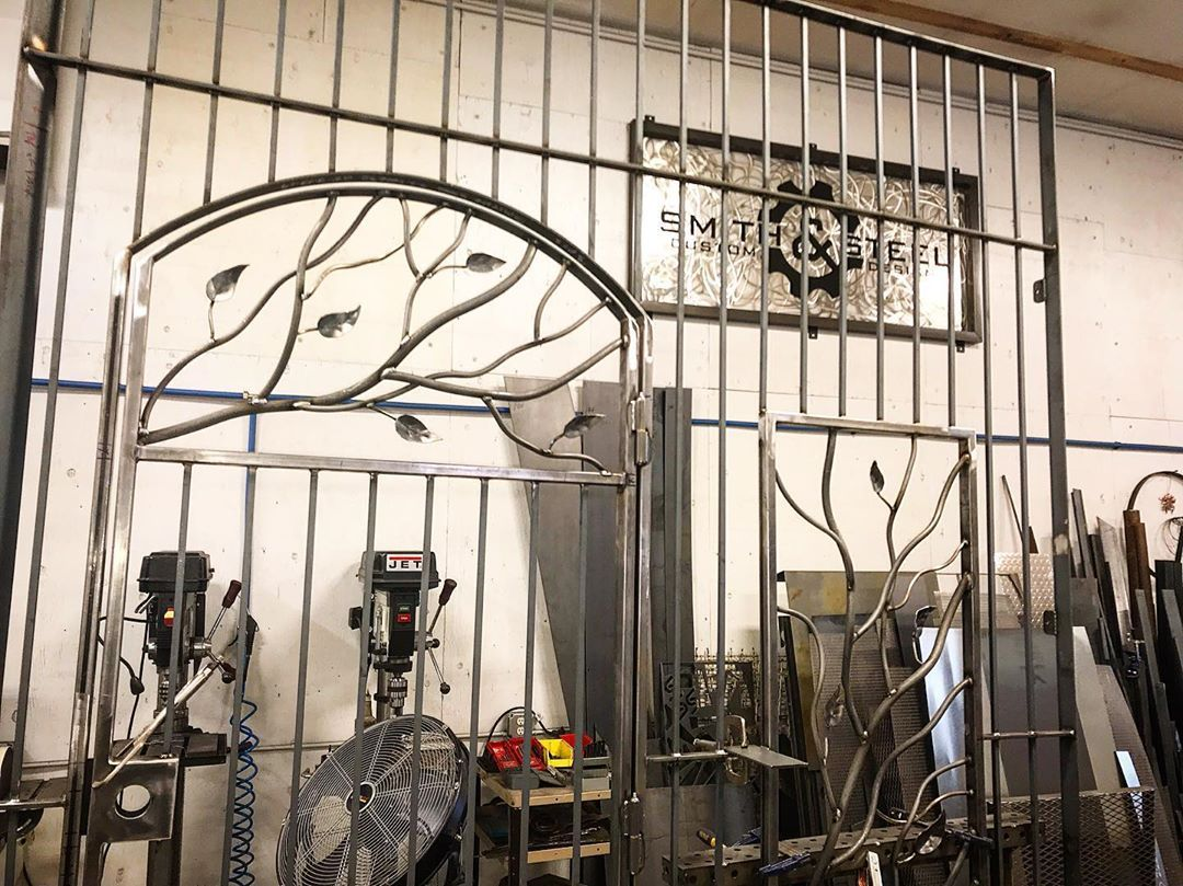 Custom Entry Panel Featuring Arched Gate And Smithandsteel Steel