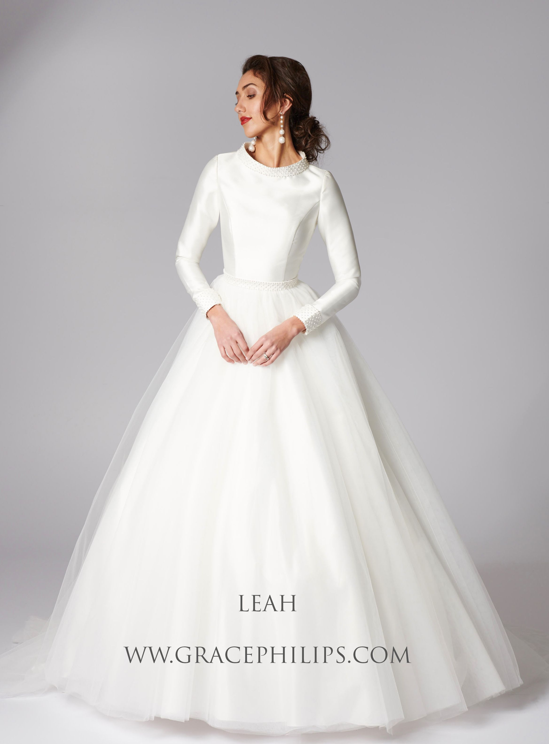Wedding dress with long train  Beautiful modest and feminine Leah is an ivory mikado and tulle