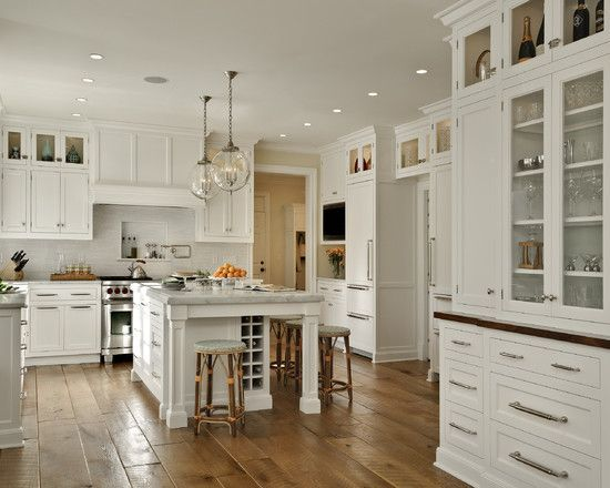 Wide Plank Flooring With White Kitchen