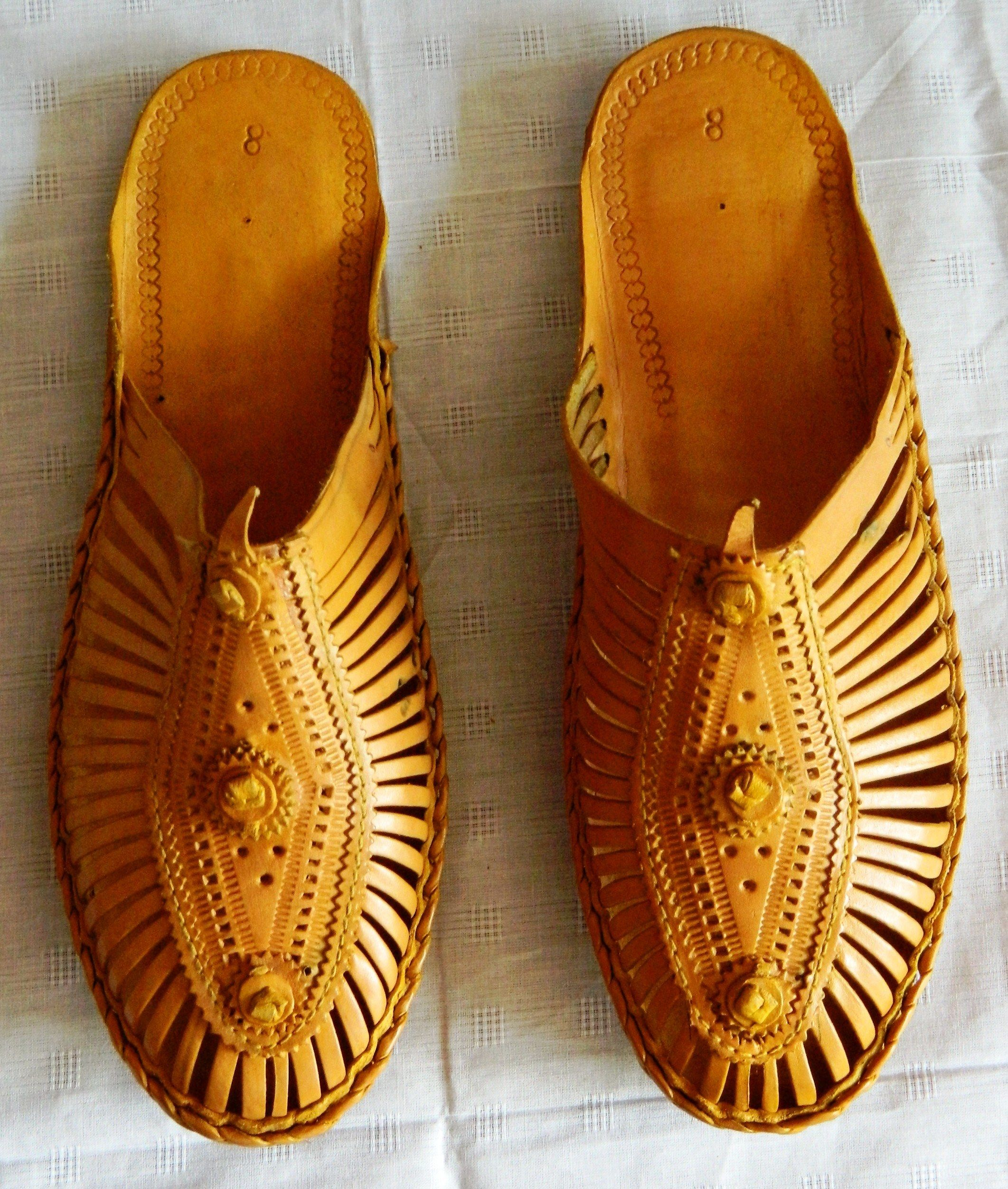 b3cab663d579 Closed front  Bantu Kolhapuri Chappals , thin layers of leather stitched  together, with beautiful straps and sturdy soles.