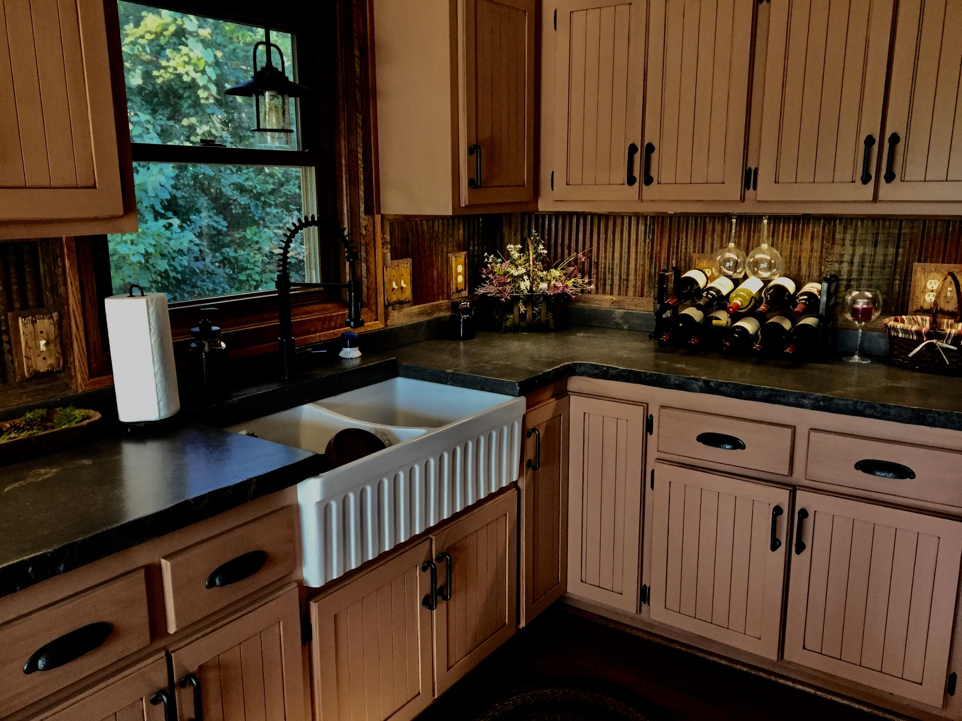 Rusty Corrugated Metal Backsplash And Concrete Counters