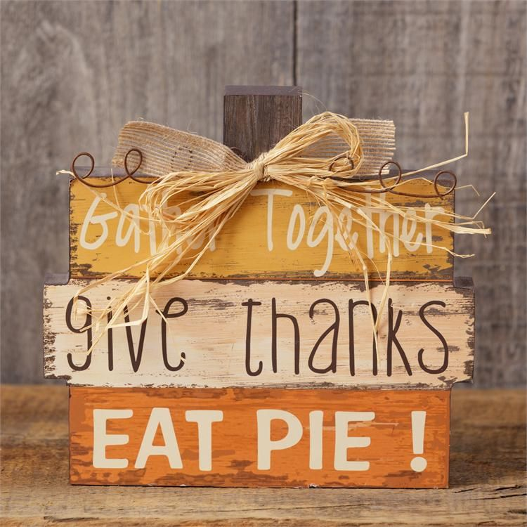 NEW!  Great new wooden fall sign.  Shaped like a pumpkin and accented with a raffia bow and wire curley-Qs.  It reads Gather Together, Give Thanks, Eat Pie.  It measures 8 tall by 7 across. #diyfalldecor