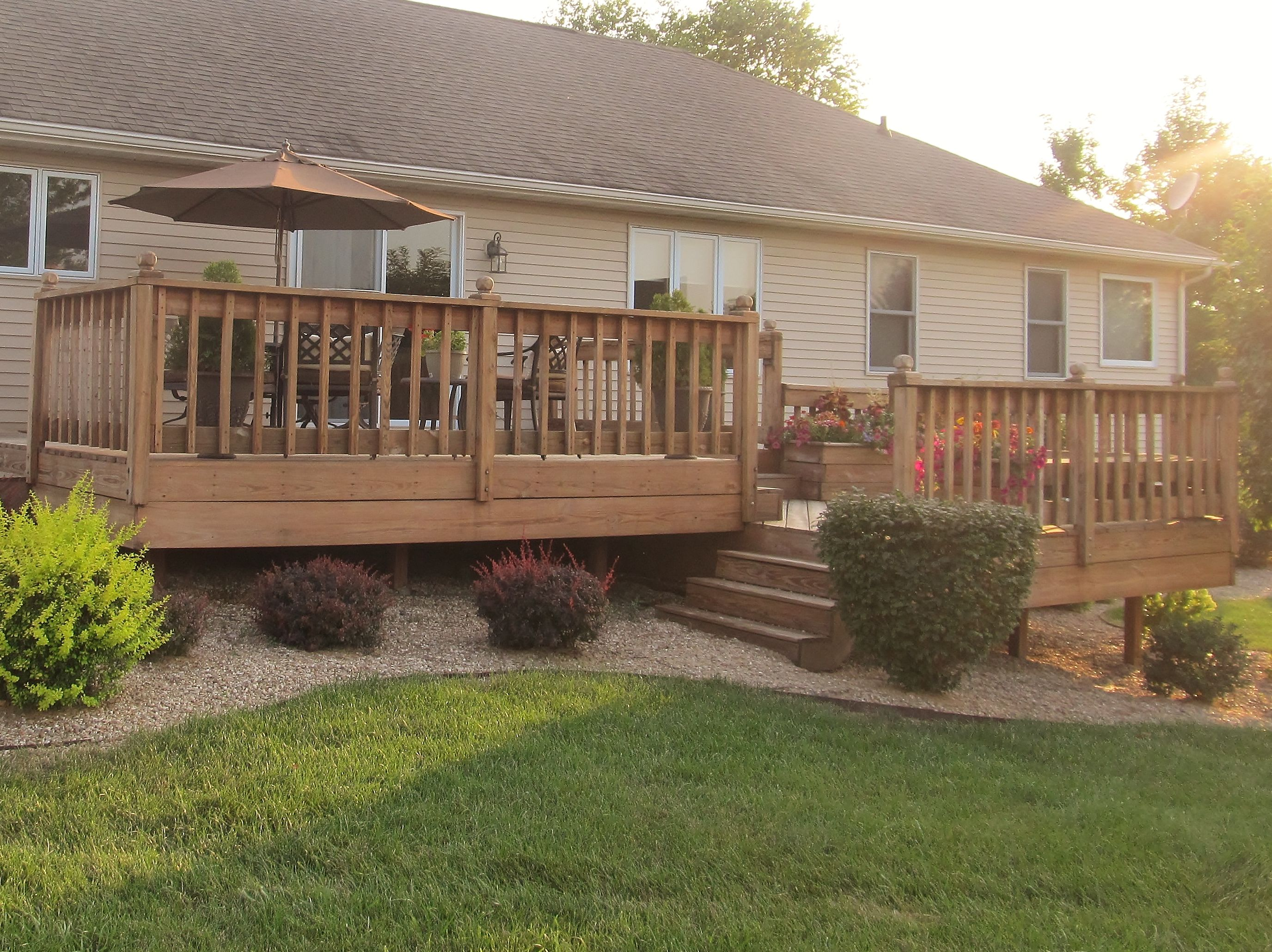 Split level deck with stairs set back but still forward for Front to back split house