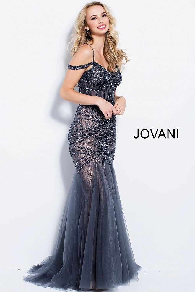 86d9dd605a3c Floor length form fitting charcoal embellished prom dress with nude  underlay and mermaid tulle bottom features off the shoulder corset bodice  with piping.