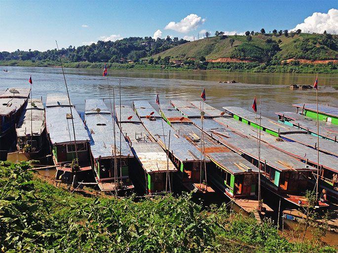 Slow boats parked at the Huay Xai border in Laos