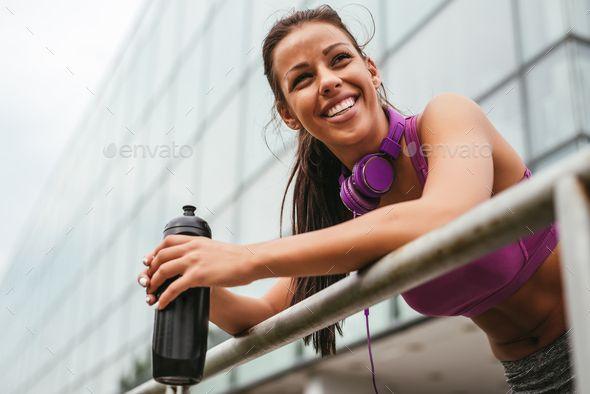 Break from fitness by bernardbodo. Attractive female athlete making a break from exercising. #AD #be...