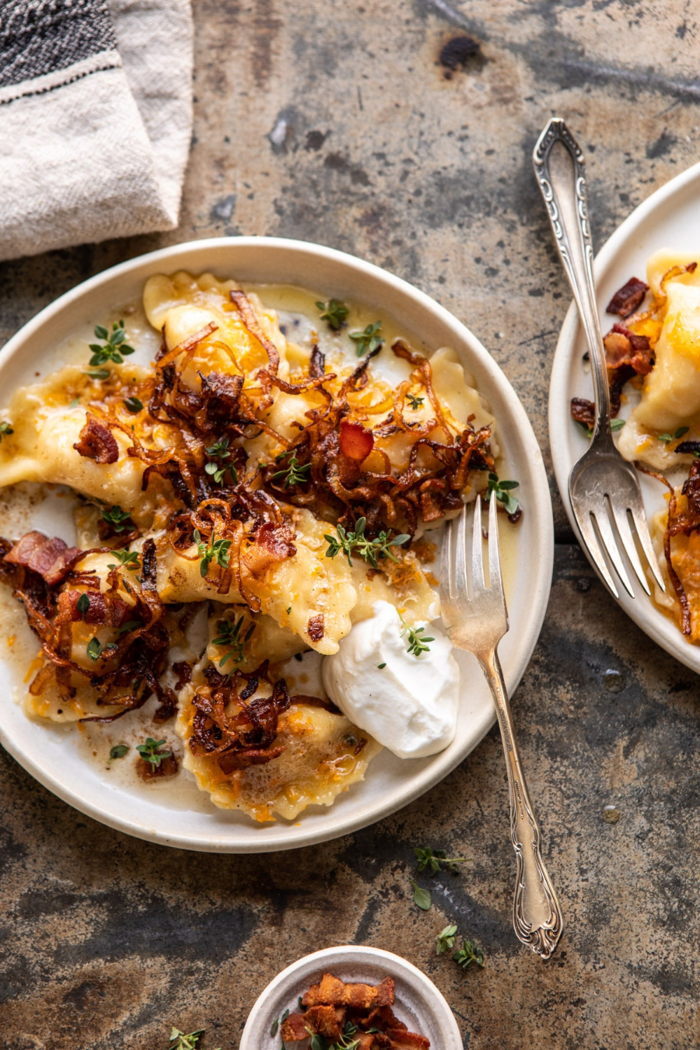 Cheddar Pierogies with Caramelized Onions and Baco