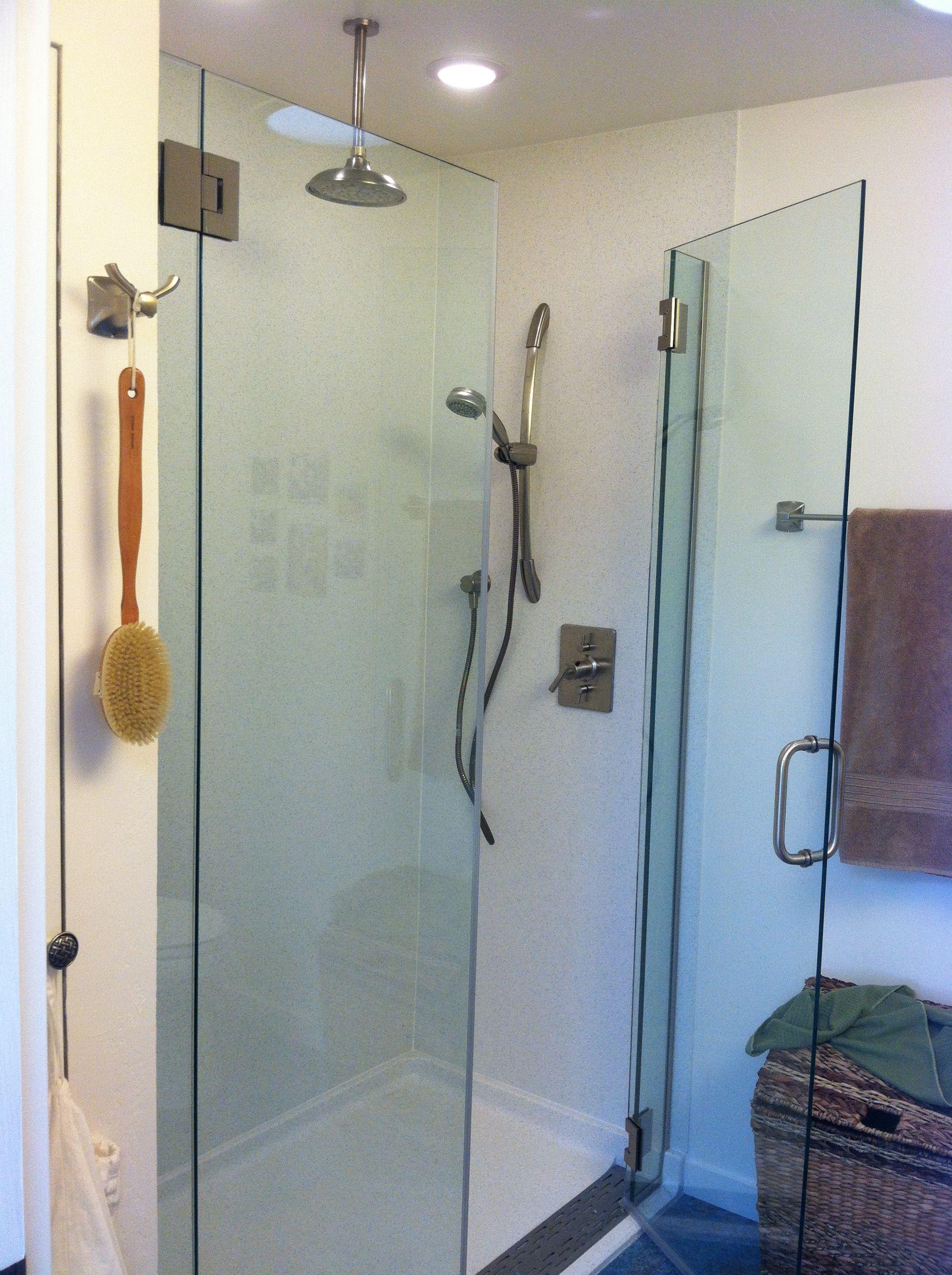 Master bathroom shower; thick frameless glass, rain head, and lights.